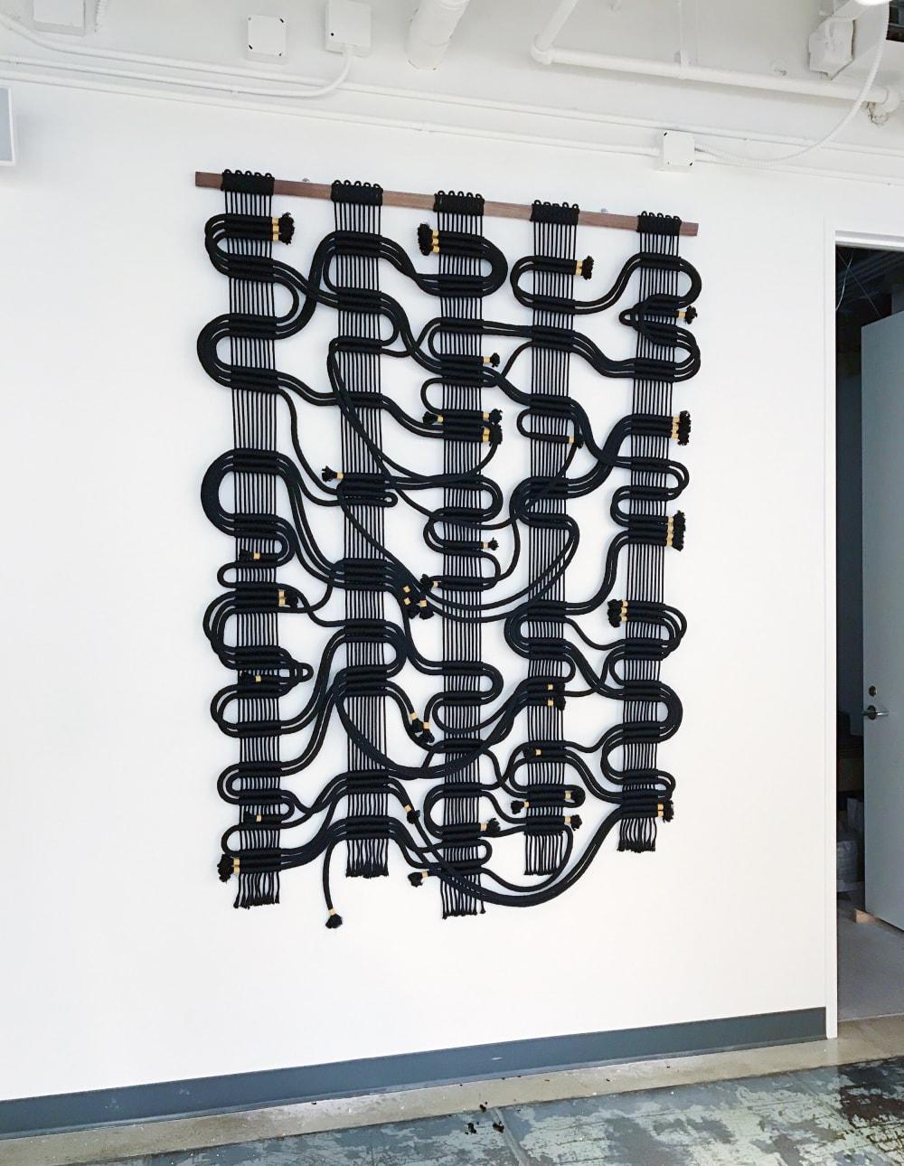 Black abstract woven macrame wall hanging
