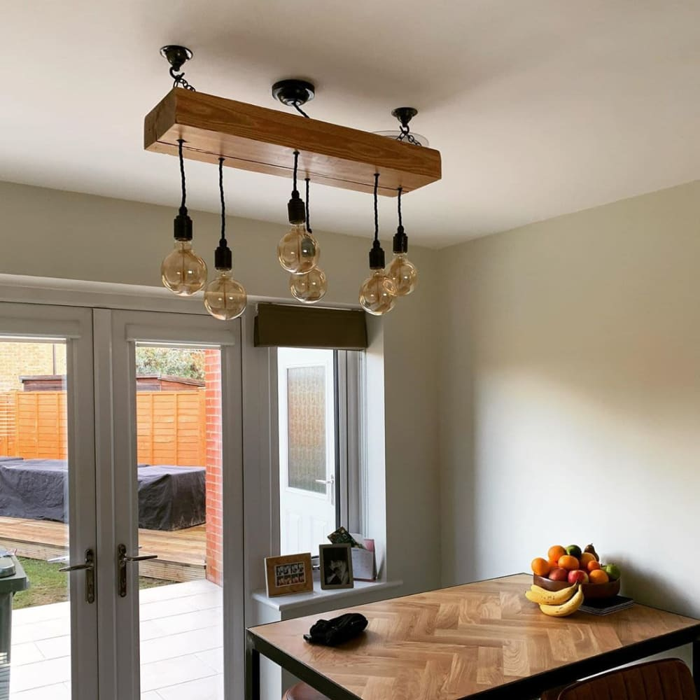 Exposed beam chandelier