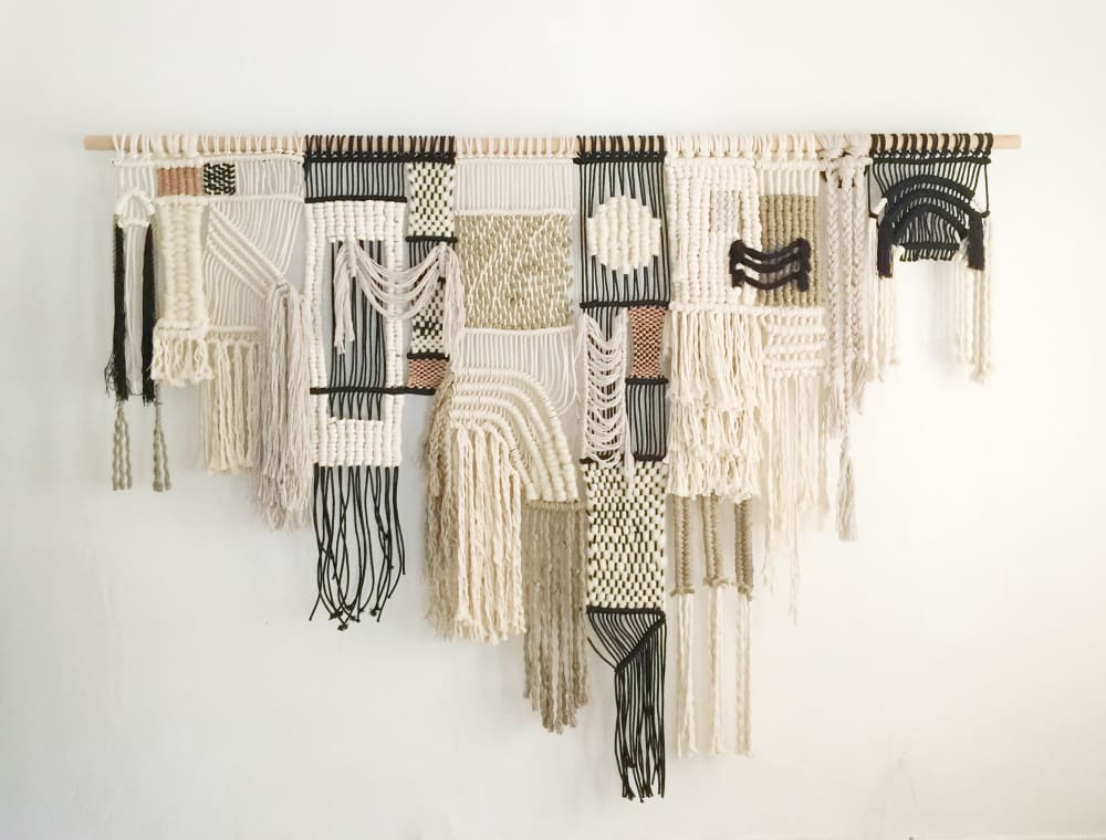 black and white woven macrame wall hanging