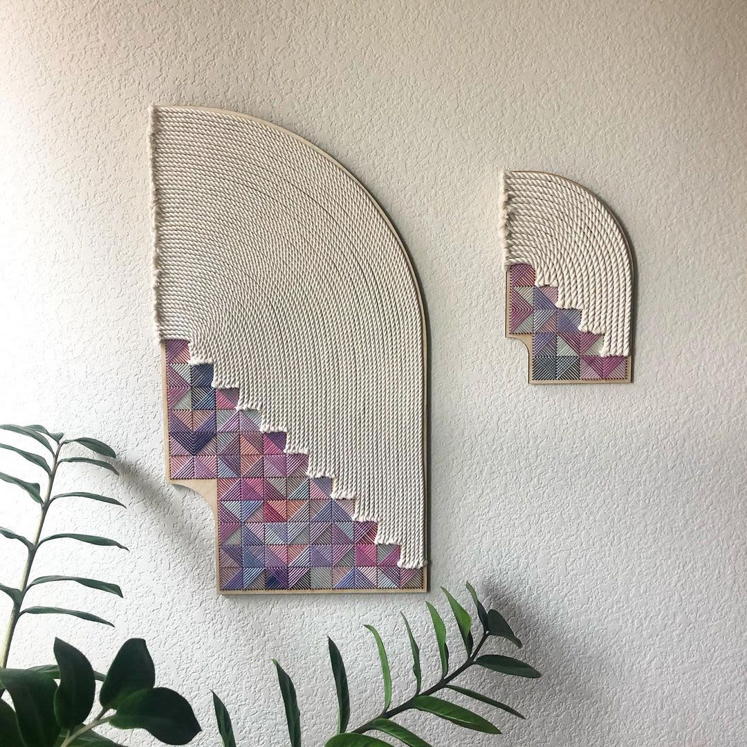 pink and purple embroidered wall hanging