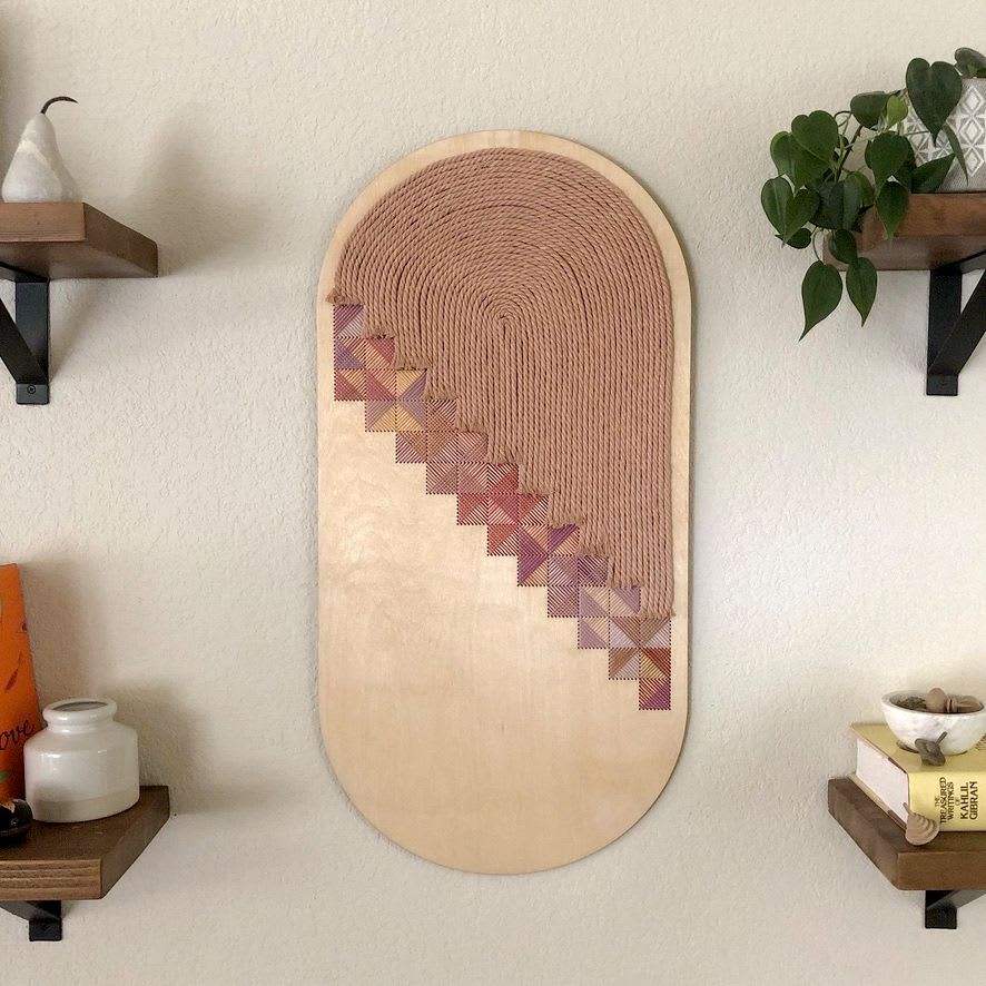 embroidered brass wall hanging