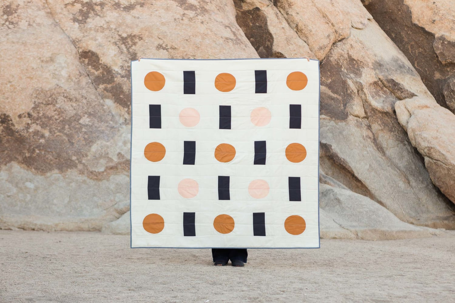 Quilt with cylinder and rectangle pattern