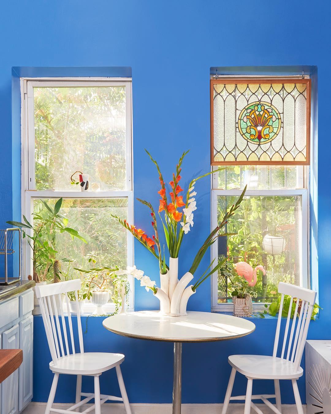 white tall bud vase blue room