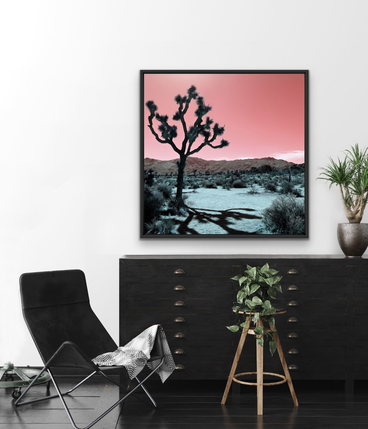 Pastel Pink and Blue Desert Scene with Silhouette of Joshua Tree in the Mid-ground