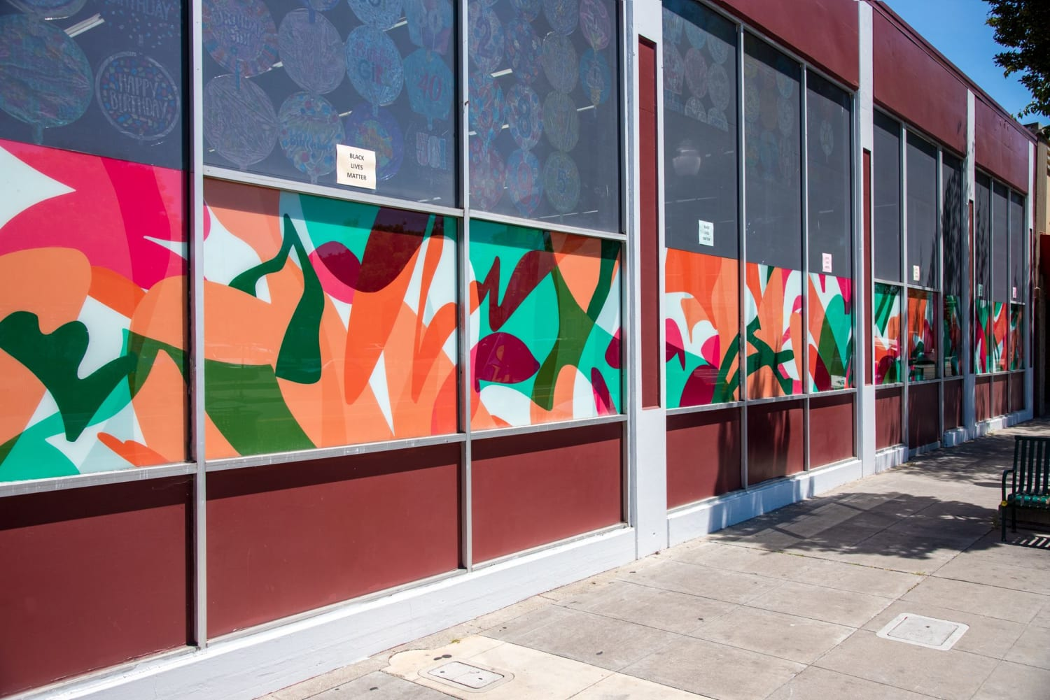Orange pink and green street mural