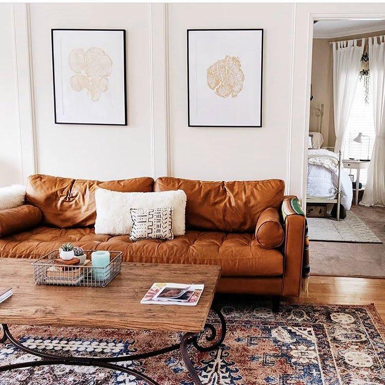 Set of gold ink tree prints in living room