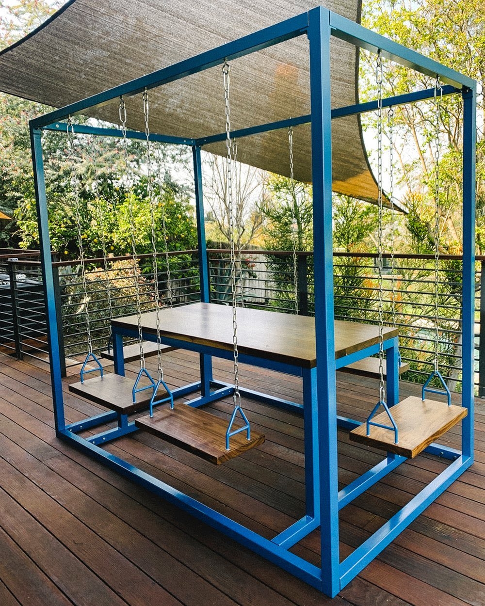 Metal hanging swingset with table