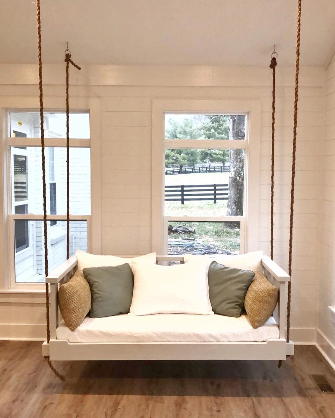 Indoor hanging bench with natural rope