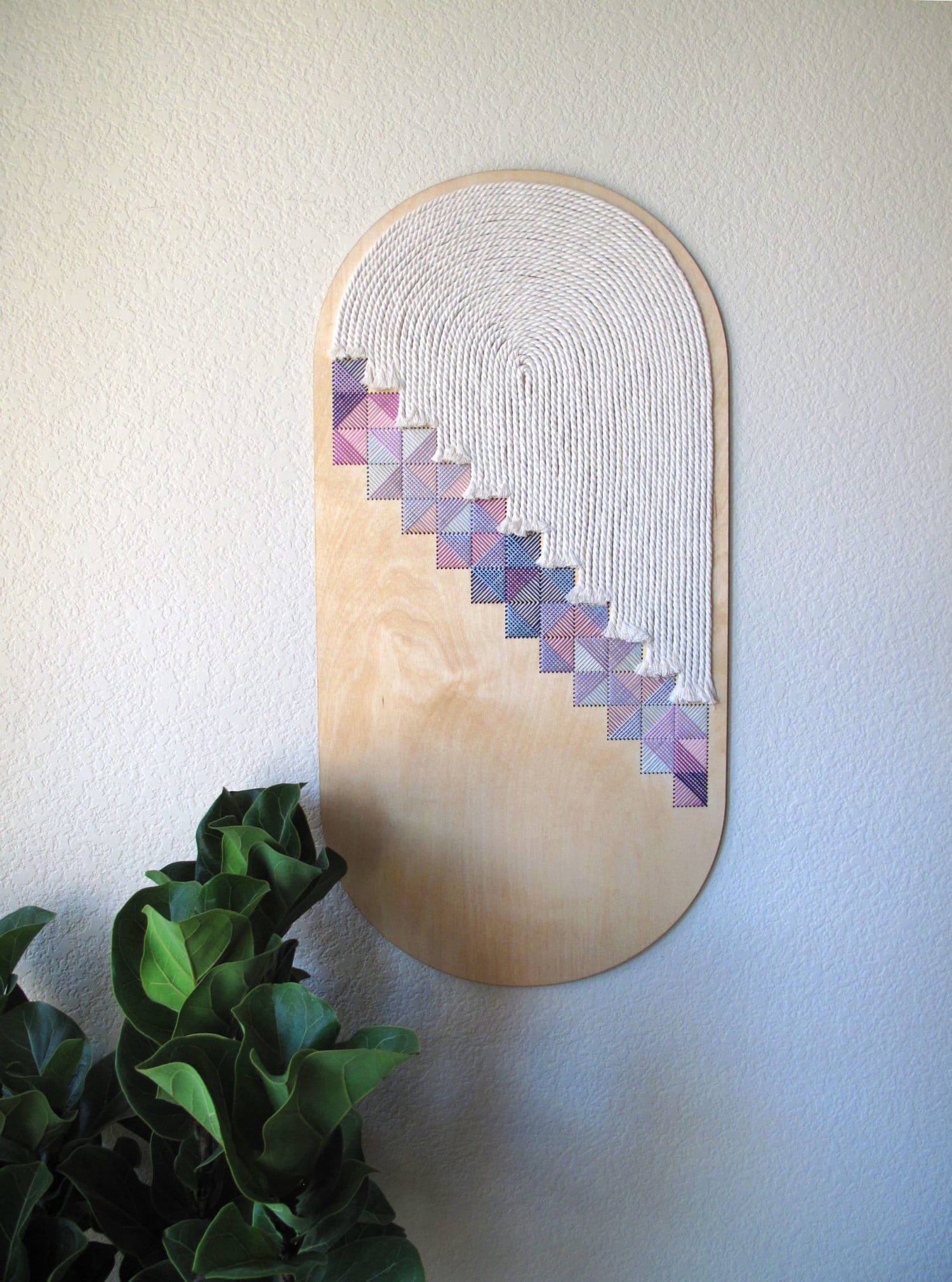 embroidered wood wall hanging