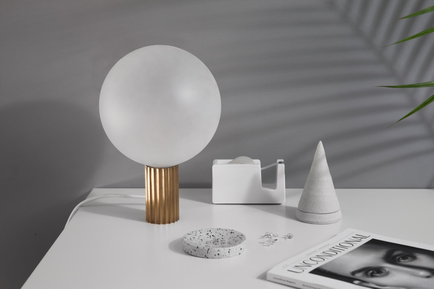 White orb lamp with gold base