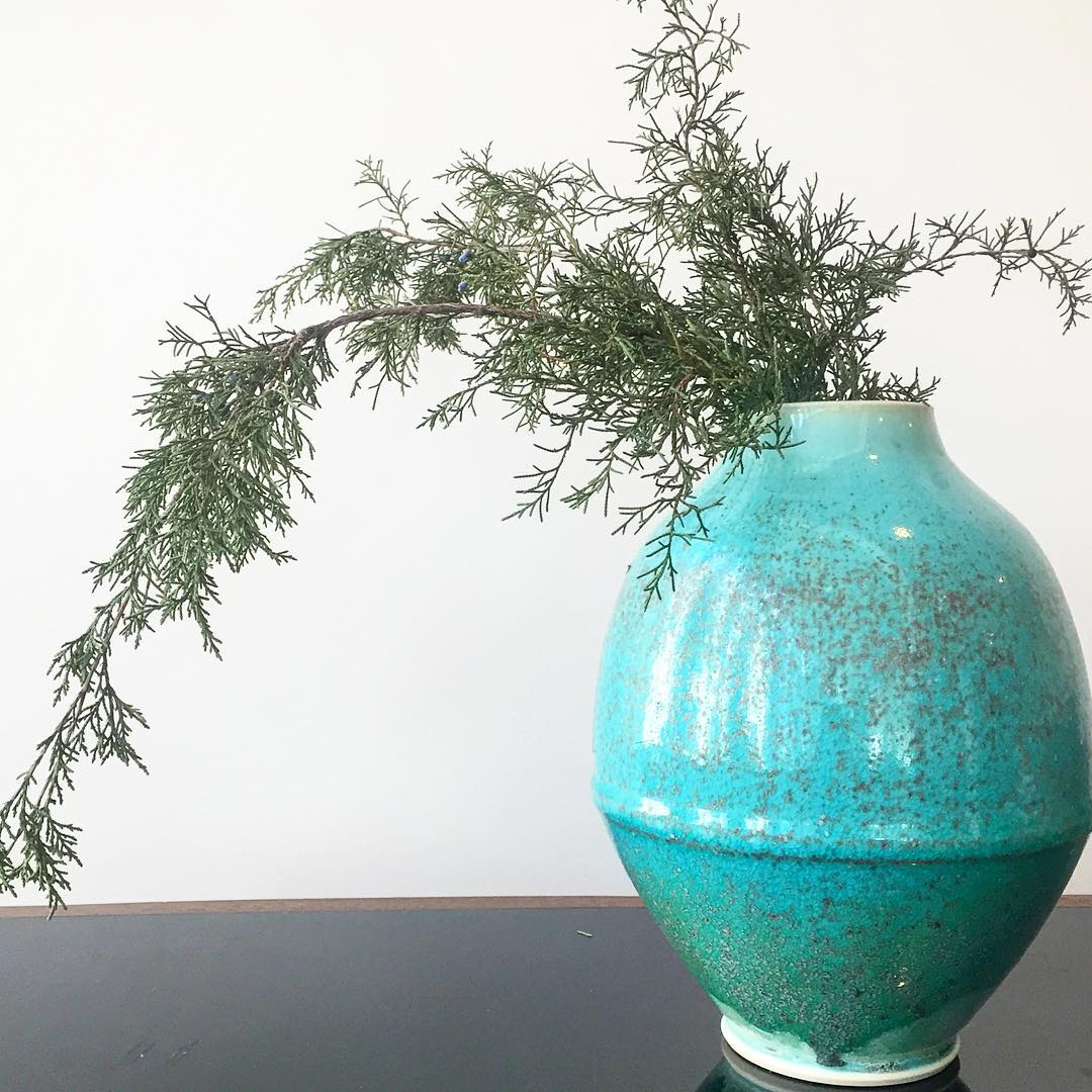 Striking Blue Egg Shaped Vase with Speckle Pattern