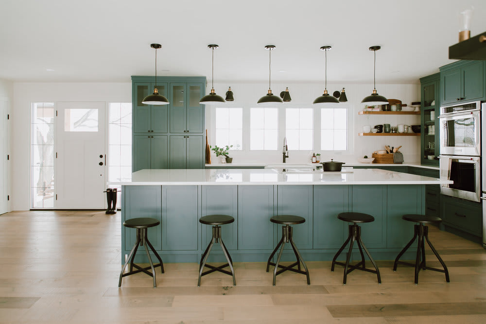 Green kitchen cabinets with island