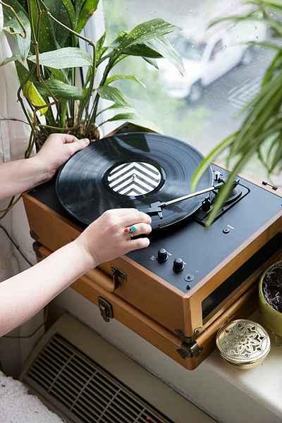 Appliances by Crosley seen at The Joshua Tree Casita, Joshua Tree - Crosley X UO Keepsake Wood Portable USB Vinyl Record Player