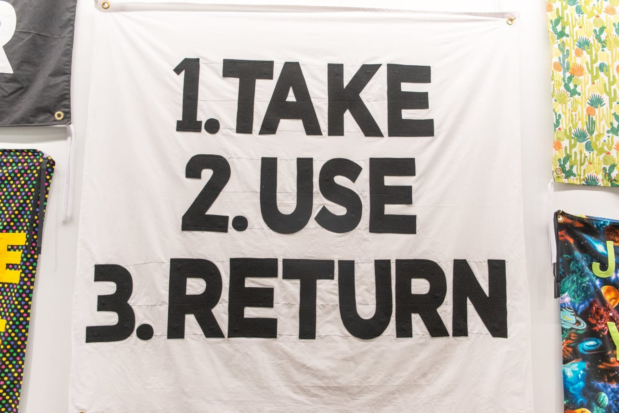 """Wall Hangings by Aram Han Sifuentes seen at Facebook Chicago, Chicago - """"Protest Banner Lending Library"""""""