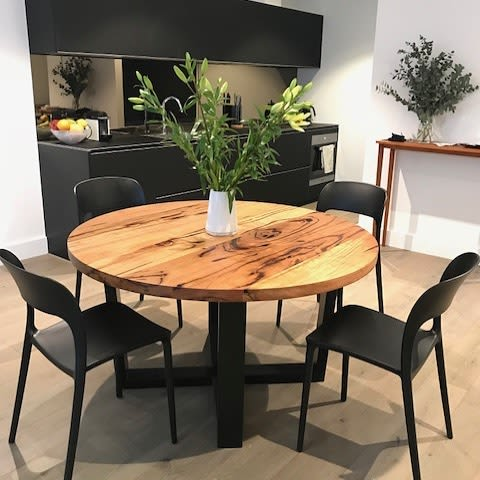 Circular wooden dining table