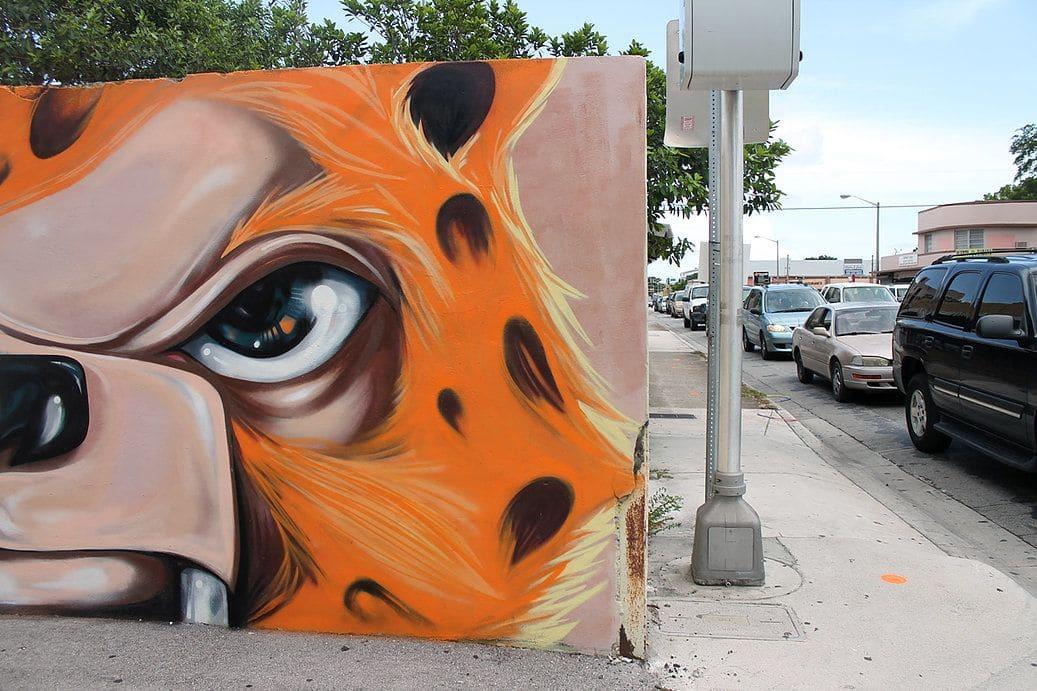 Street Murals by Yuhmi Collective seen at Little Havana, Miami - Geisha Mermaid & Saber Jaguar