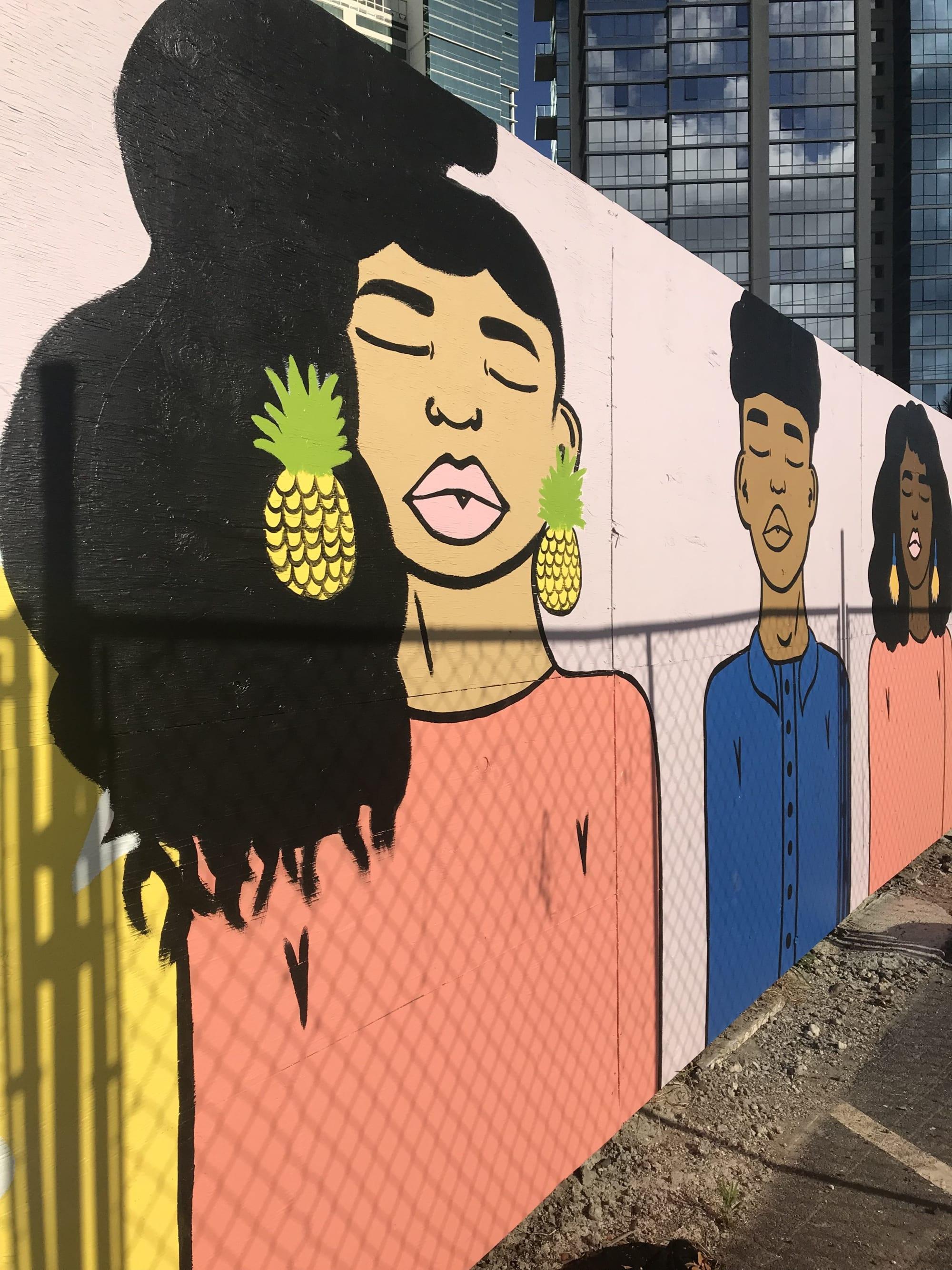 Girl with pineapple earrings mural