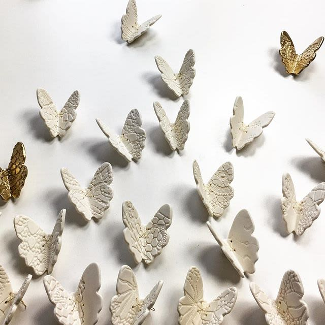 White and gold textured butterfly wall decor