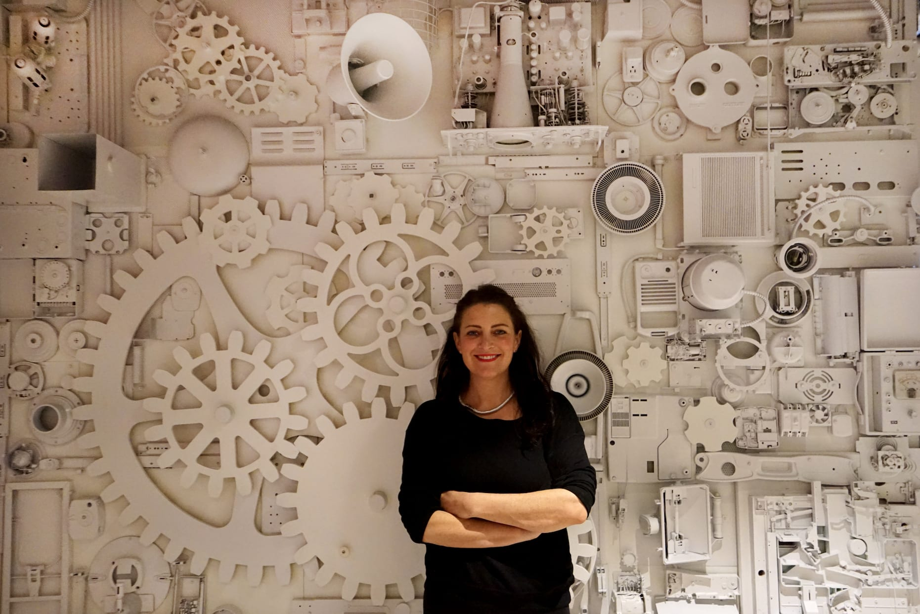 Monochromatic Industrial Wall Treatment with Gears and Electronics