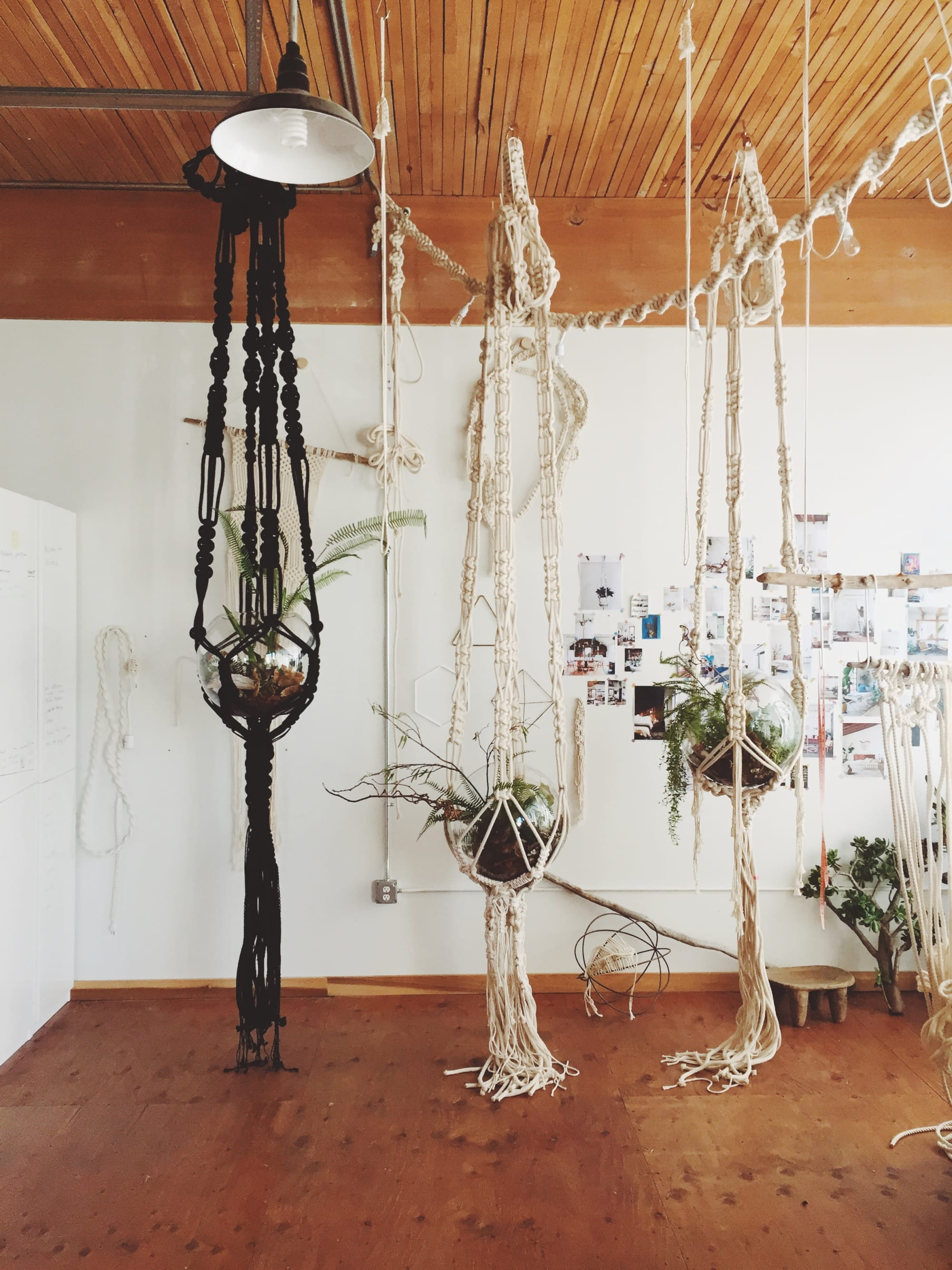 Macrame woven plant hanger with glass planter