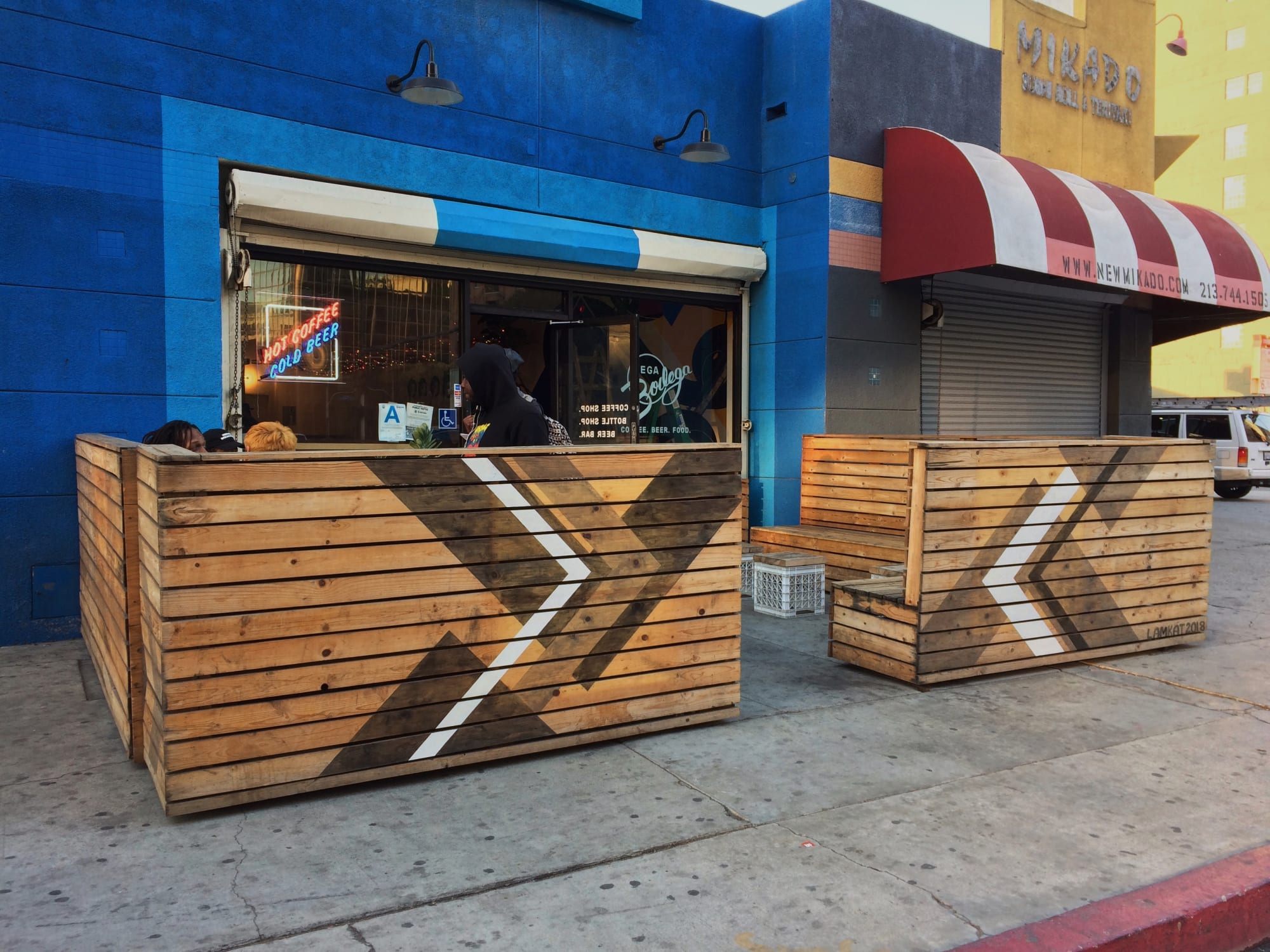 Murals by LAMKAT seen at Mega Bodega, Los Angeles - Stained Entrance