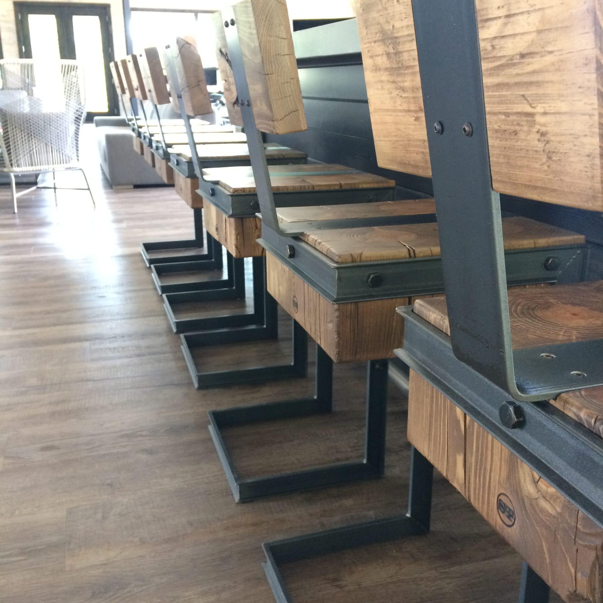 Chairs by Stål Timber seen at Private Residence, Dallas - Reclaimed Timber and Steel Bar Stools
