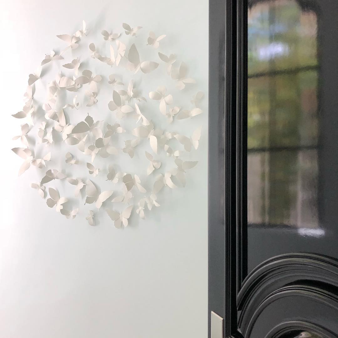 Delicate white circular butterfly wall decor