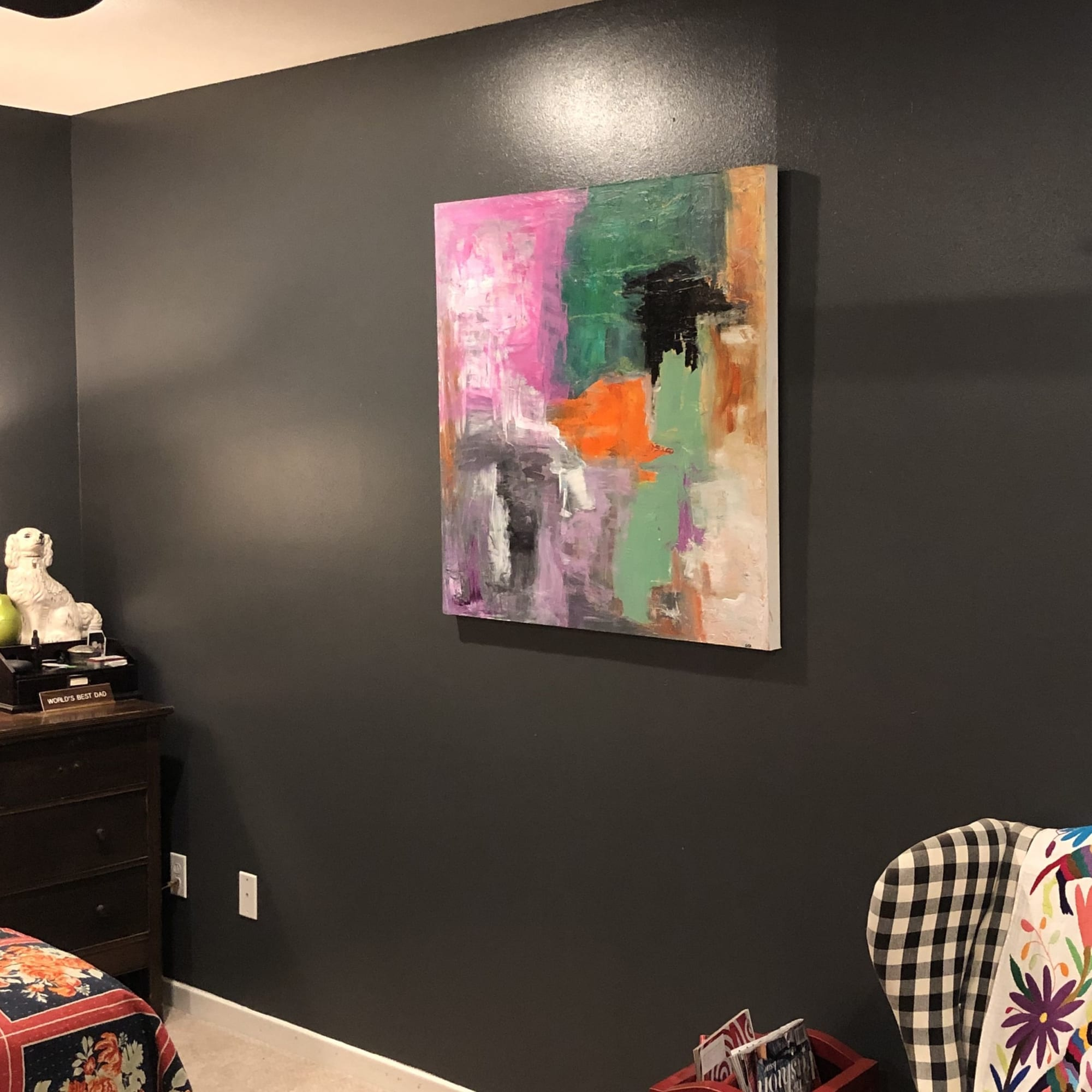 Multicolor abstract painting on black wall