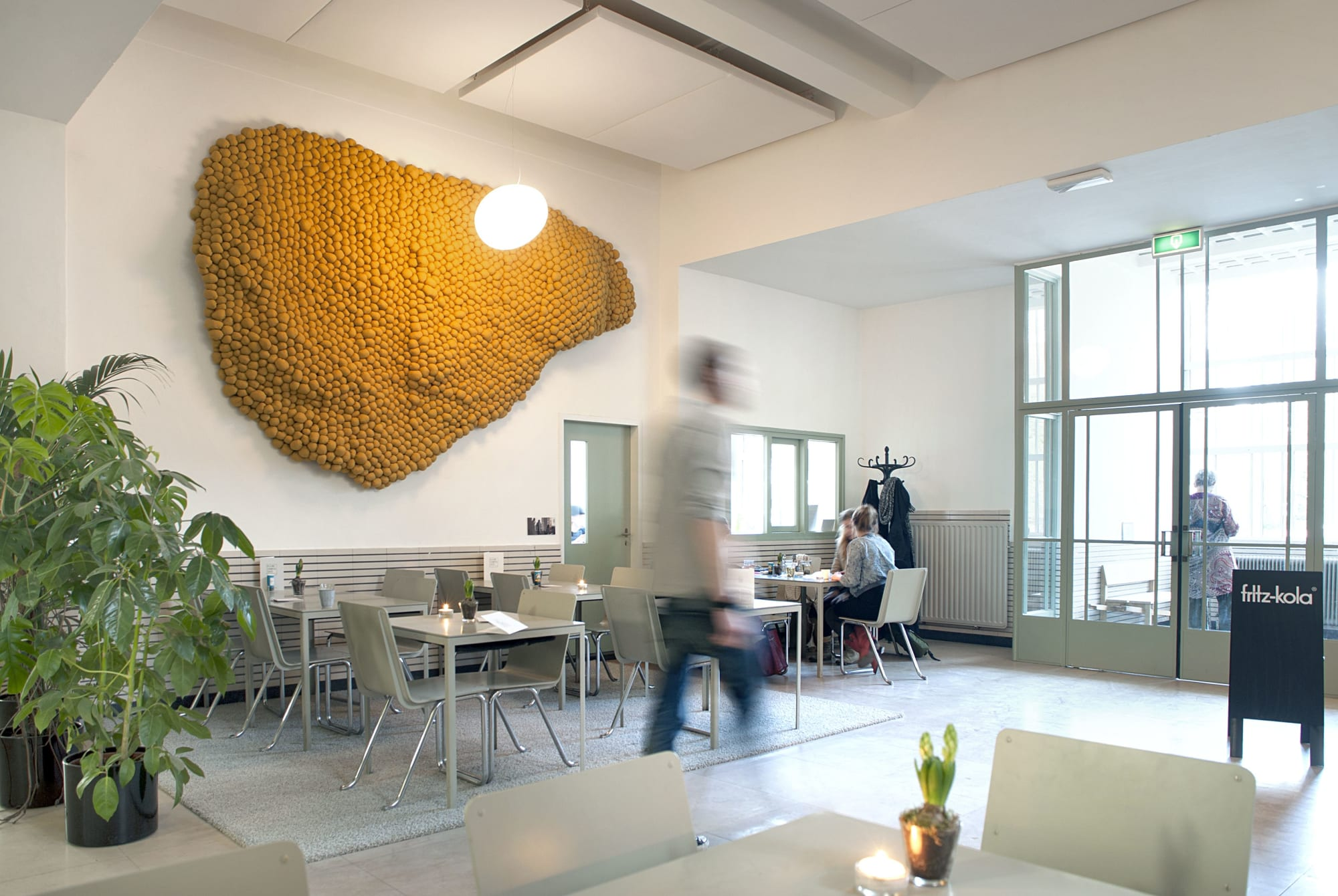 Large textile wall art in yellow ochre