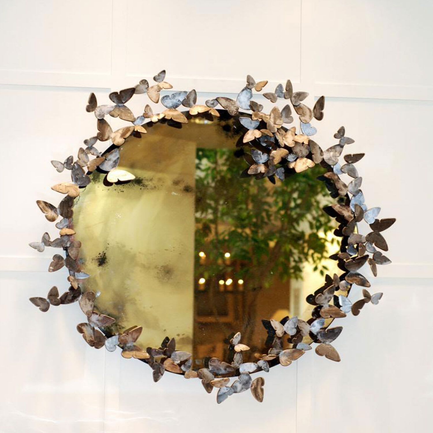 Metal butterfly accent circle mirror