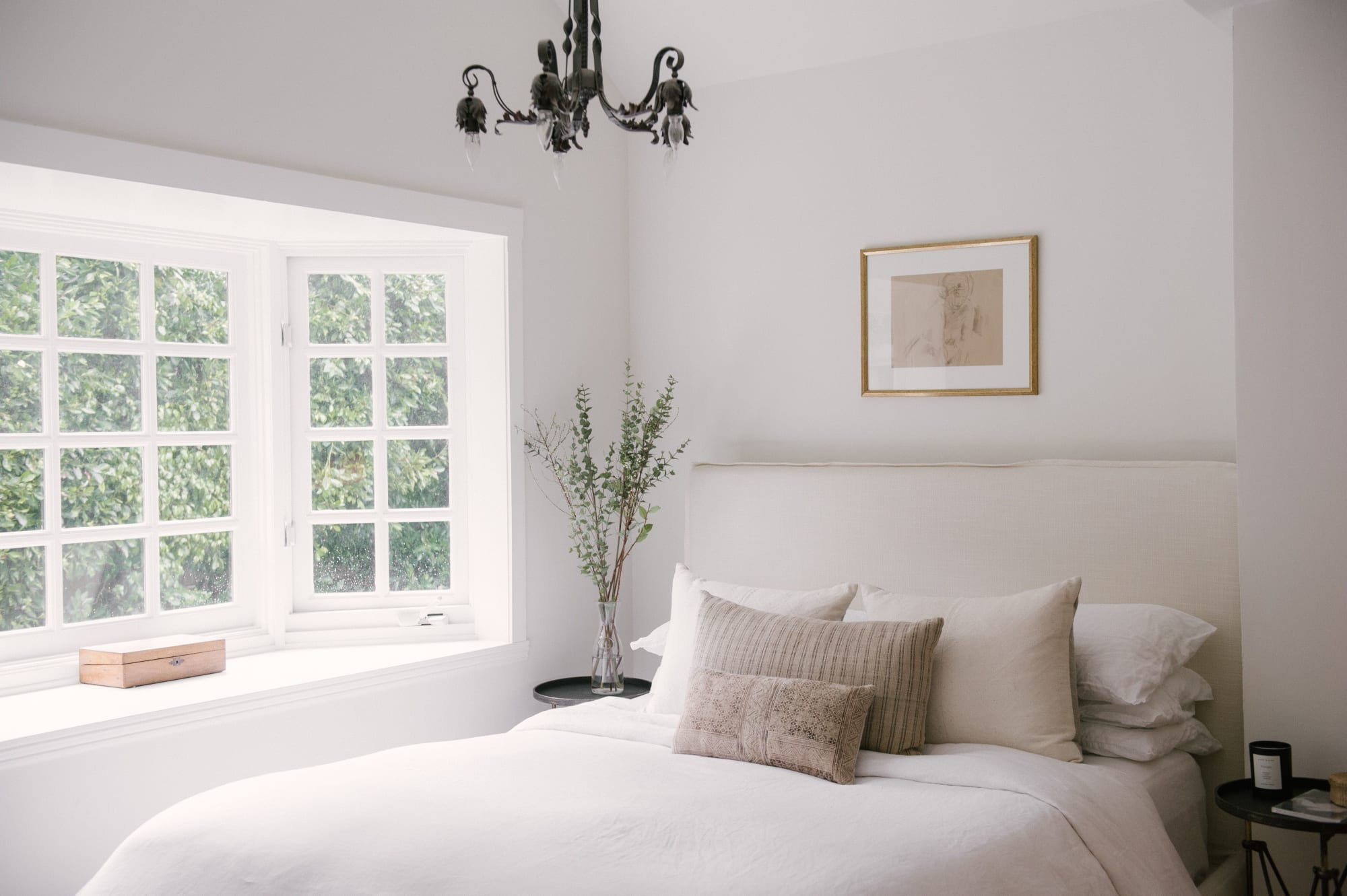 White and gray interior bedroom, light bed, pillows