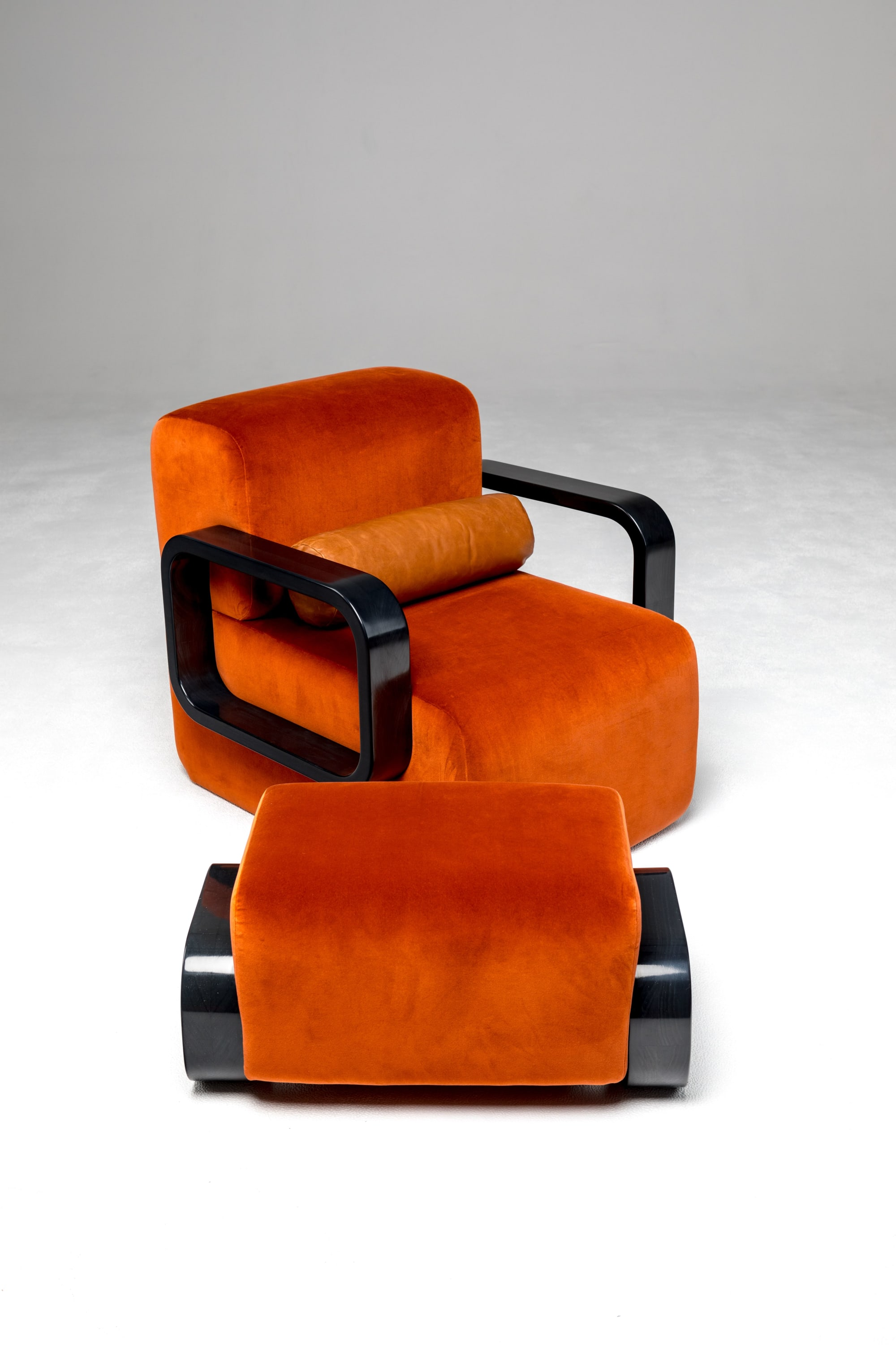 Bright orange velvet lounge chair