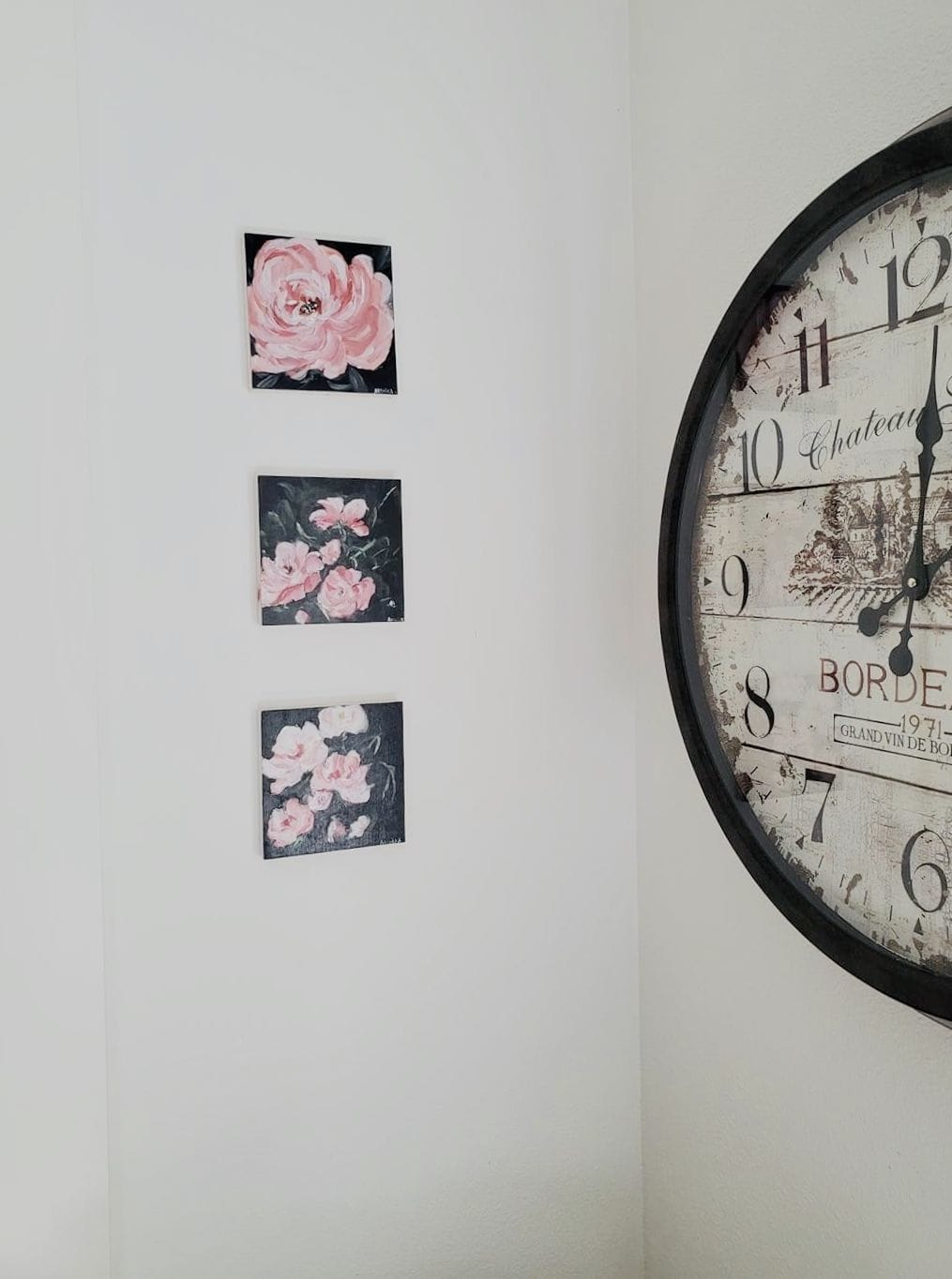 Pink flower paintings on 3 canvases