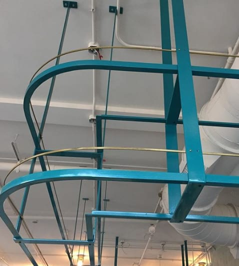 Furniture by Metal Fred seen at Stay Golden, Nashville - Hanging curved bar