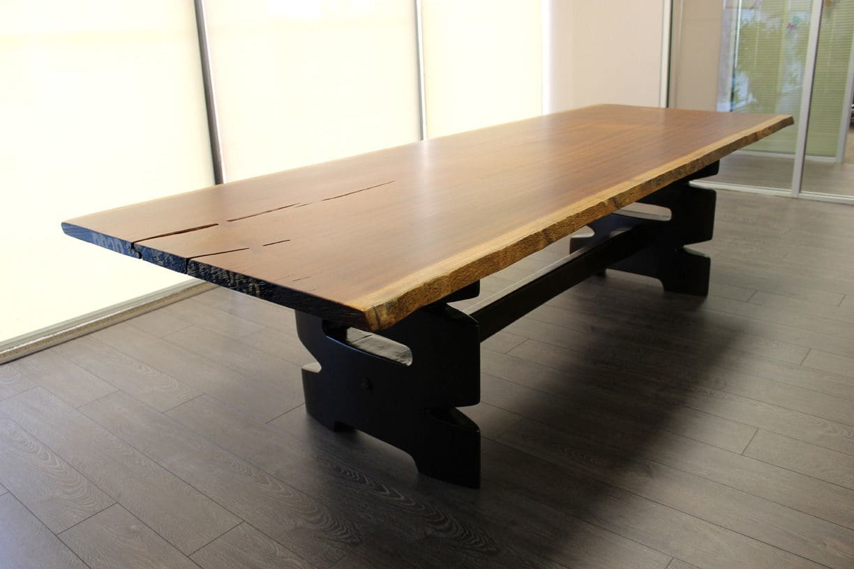 Tables by Andrew Reid SHEd seen at Brustman Carrino Public Relations, Miami - Custom Top Table with Carved Legs