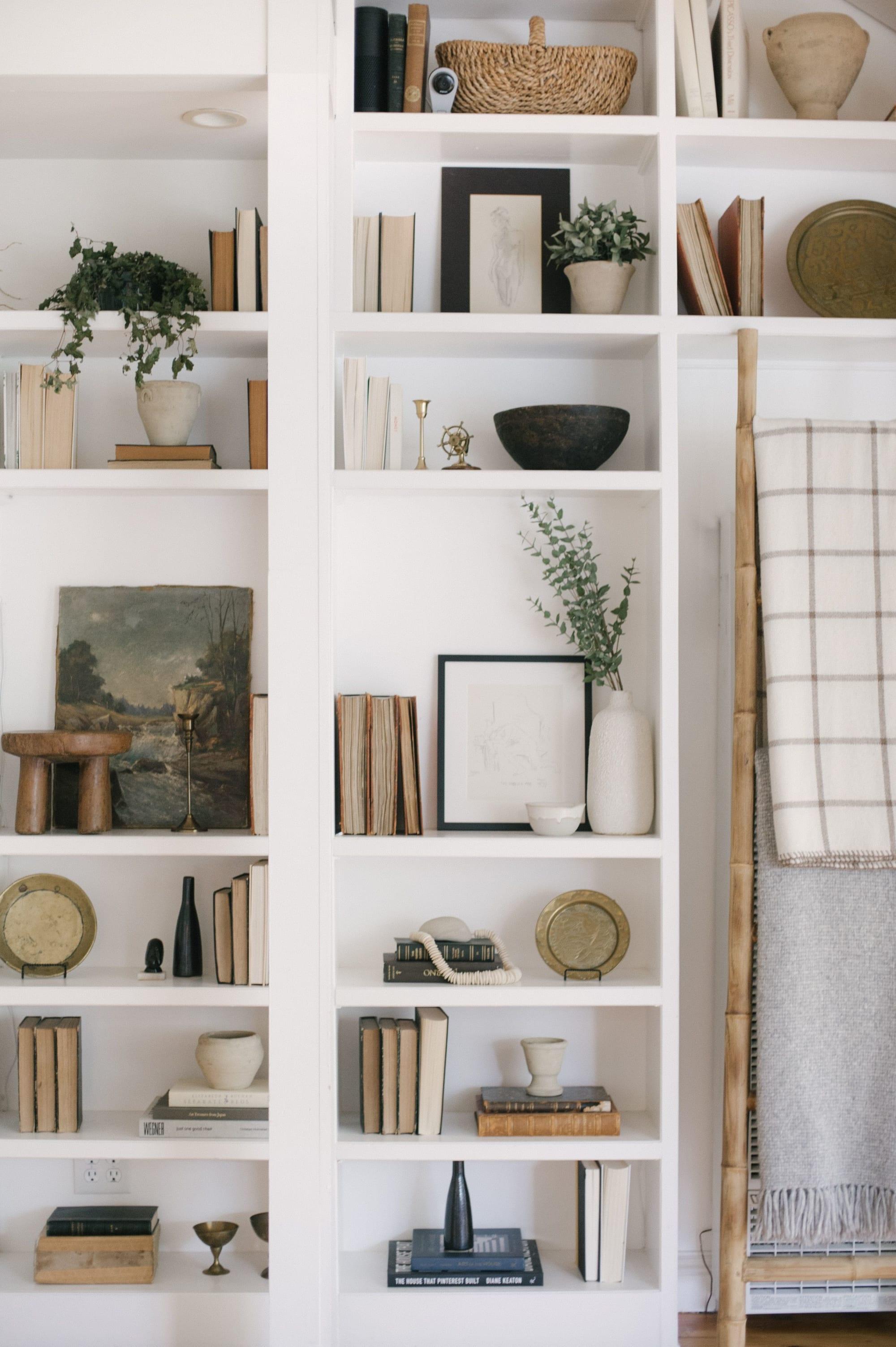 White shelves, organized decorations