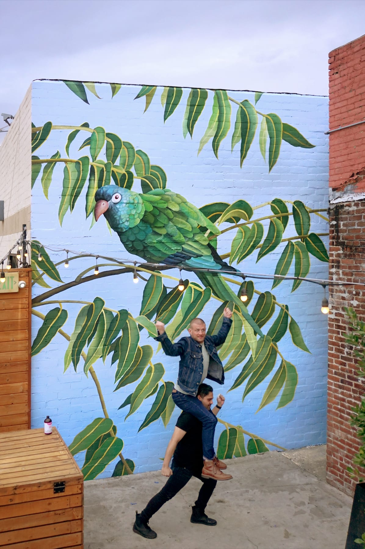 Murals by Celeste Byers seen at Block Party Highland Park, Los Angeles - Green Parrot