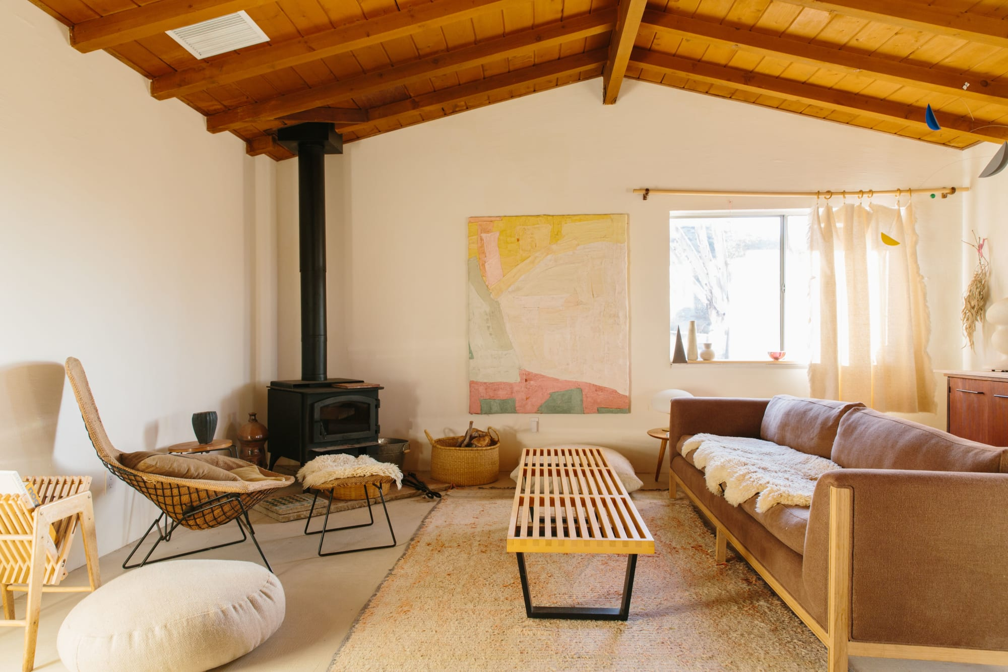 Chic living room with textiles and natural wood