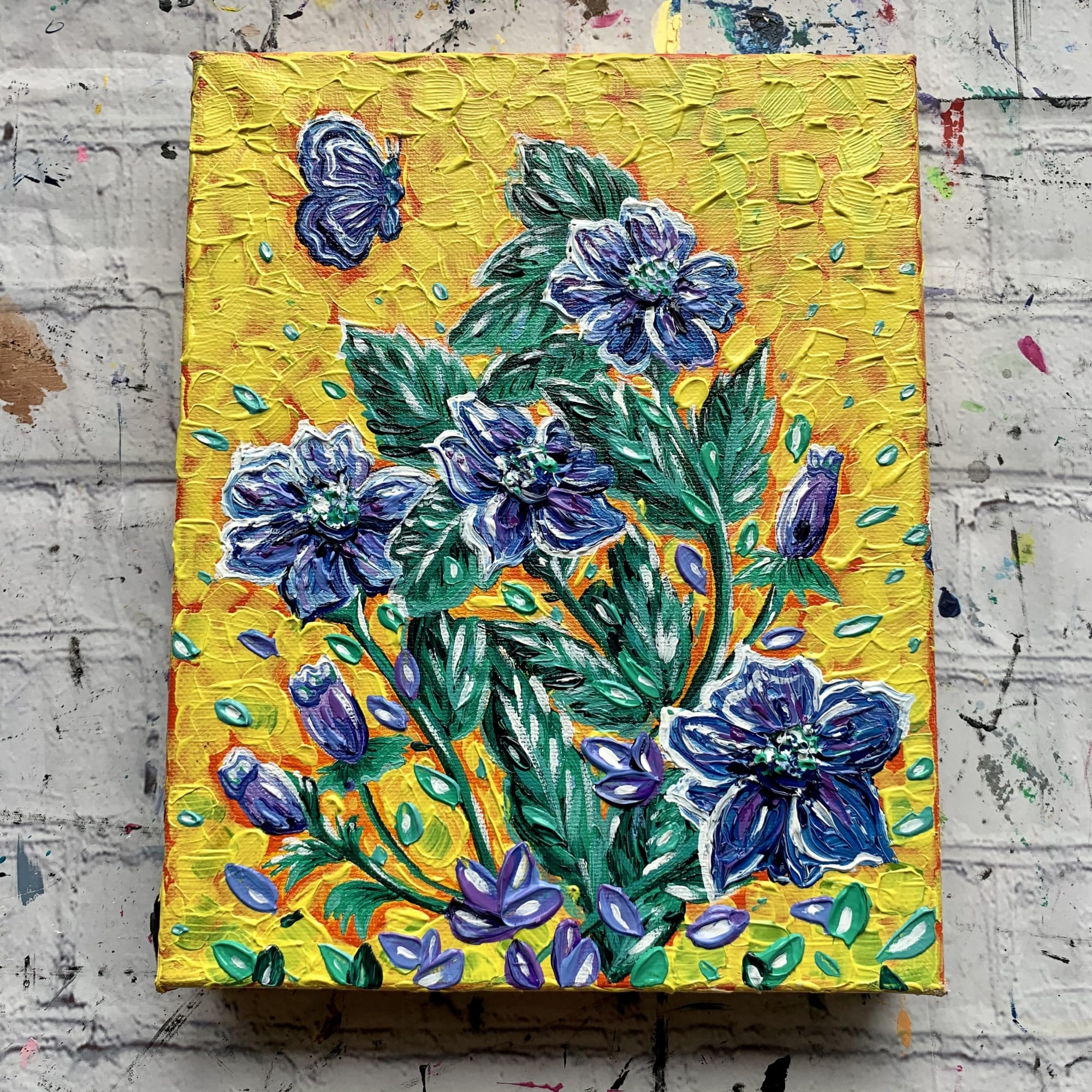 Blue and green on yellow flower painting