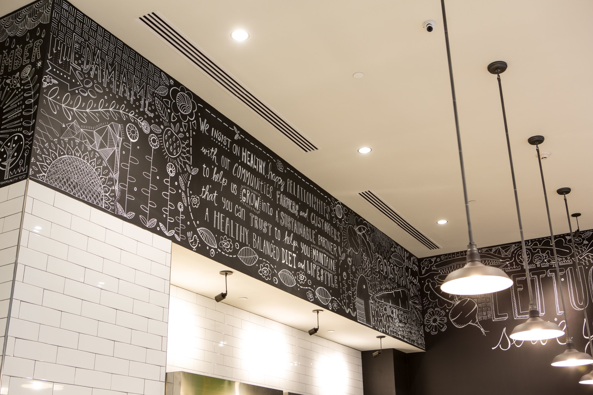 Murals by Kim Fox seen at 611 William Penn Pl, Pittsburgh - Earth Inspired Salads restaurant mural