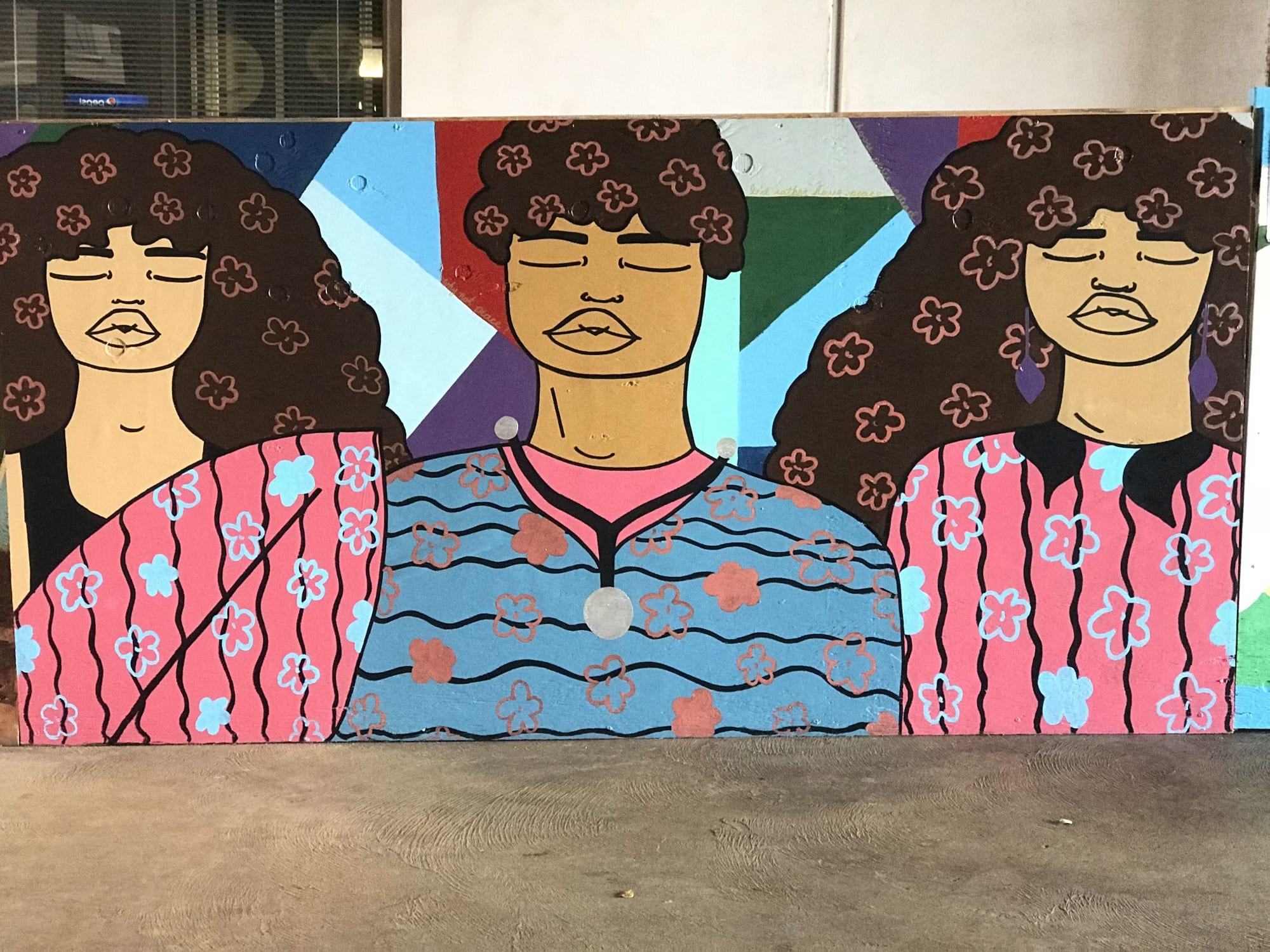 Mural of girls and boy with floral pattern