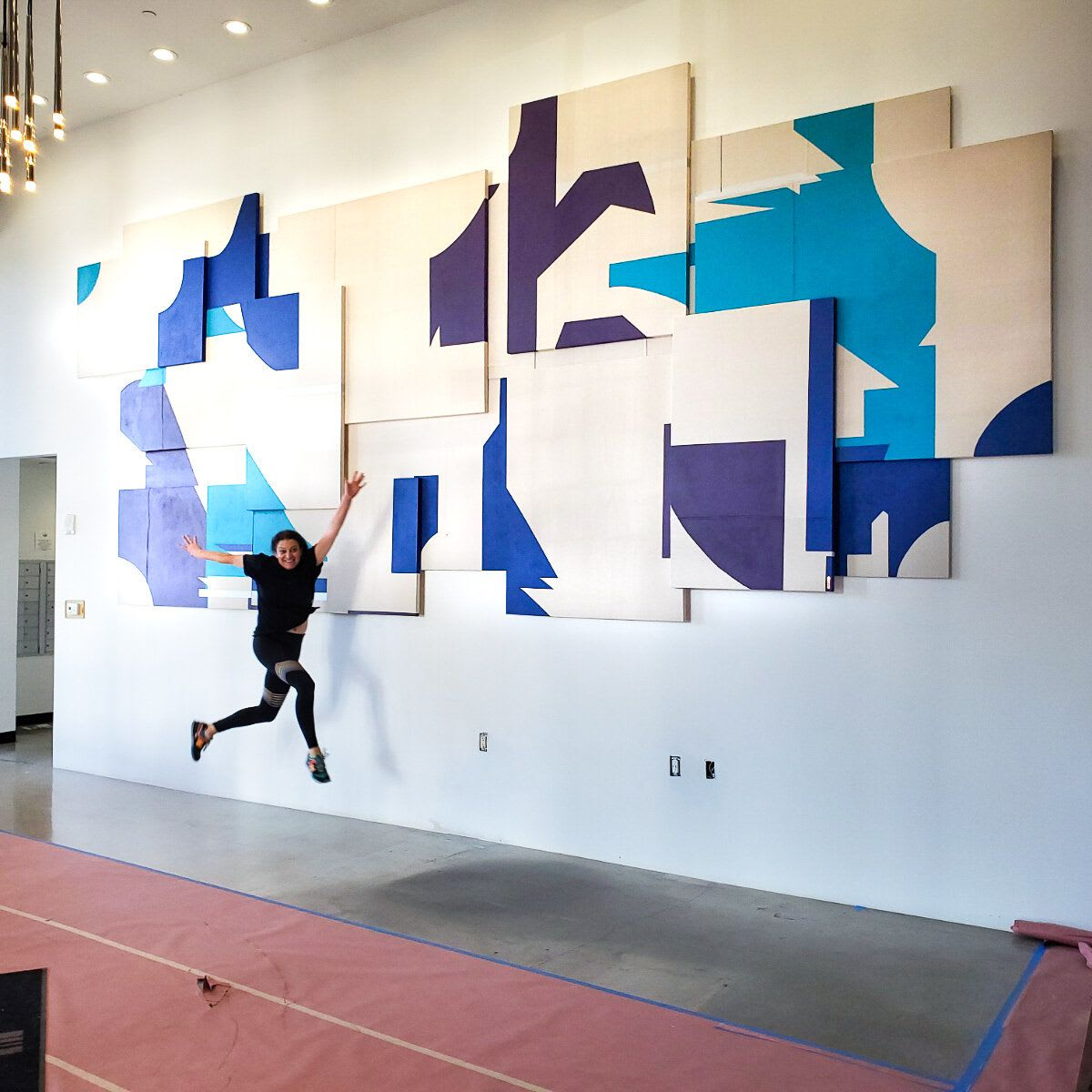 Layered Geometric Wall Sculpture with Blue Accents