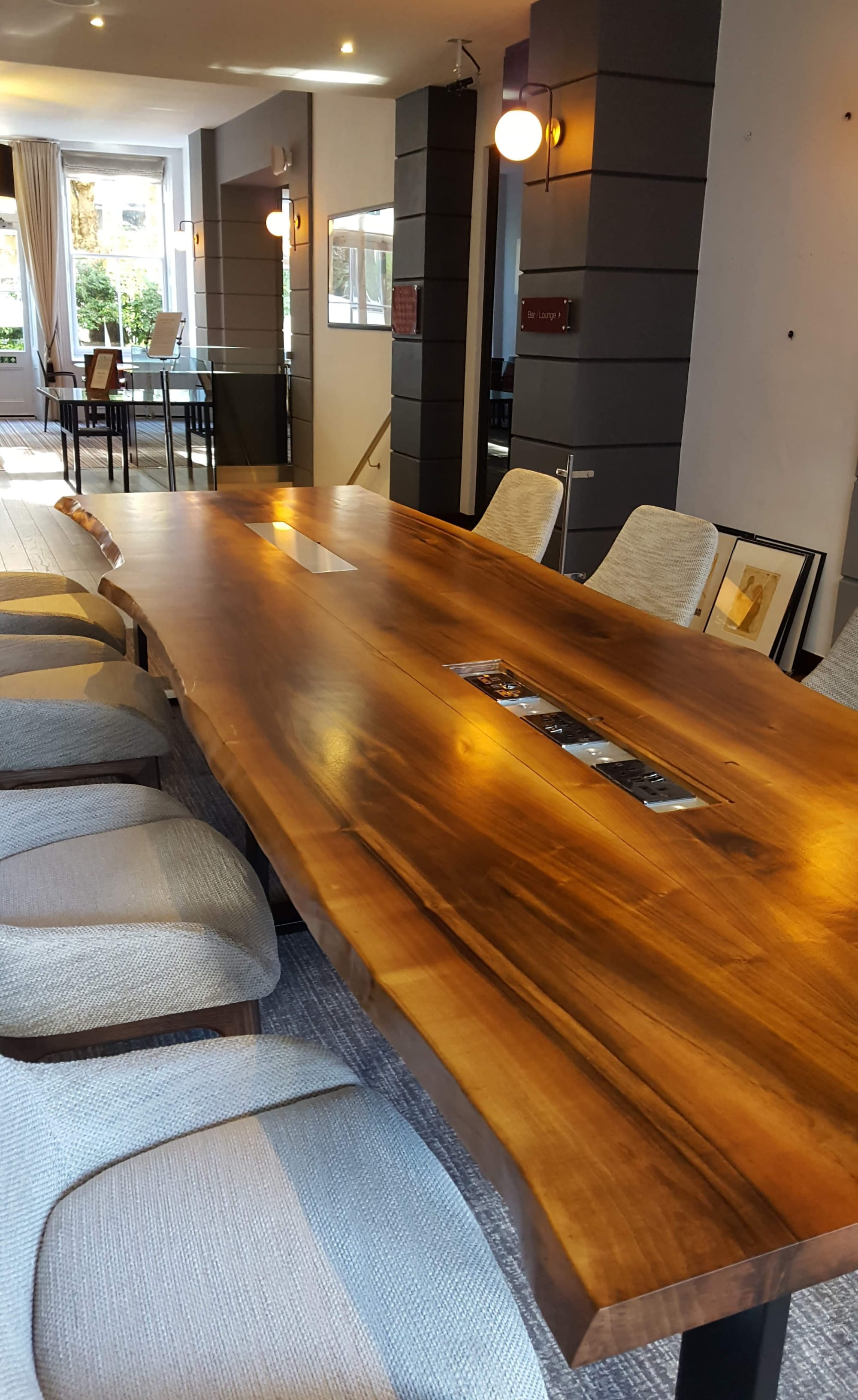 Tables by Handmade in Brighton seen at K+K Hotel George Kensington, London - Serbian Walnut Live-Edge Sharing Table