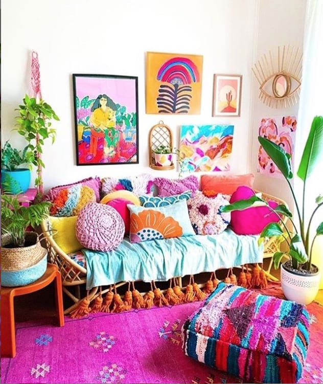 Bright pink boho room with abstract paintings