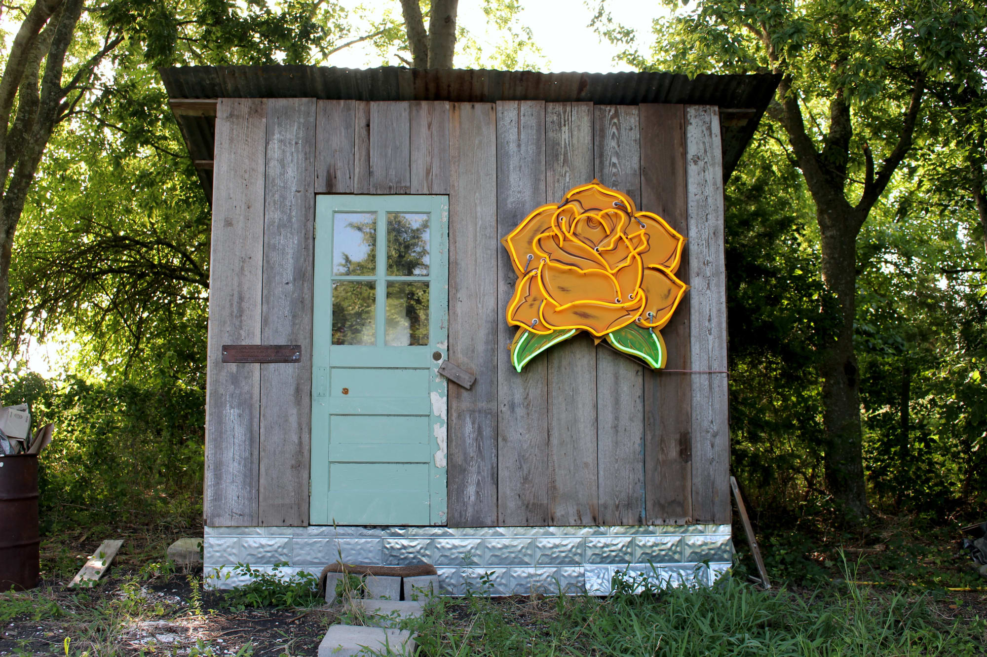 Neon yellow rose artwork on shed