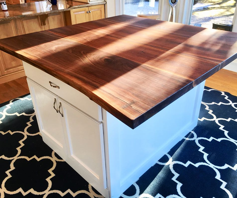 White cabinets walnut countertop