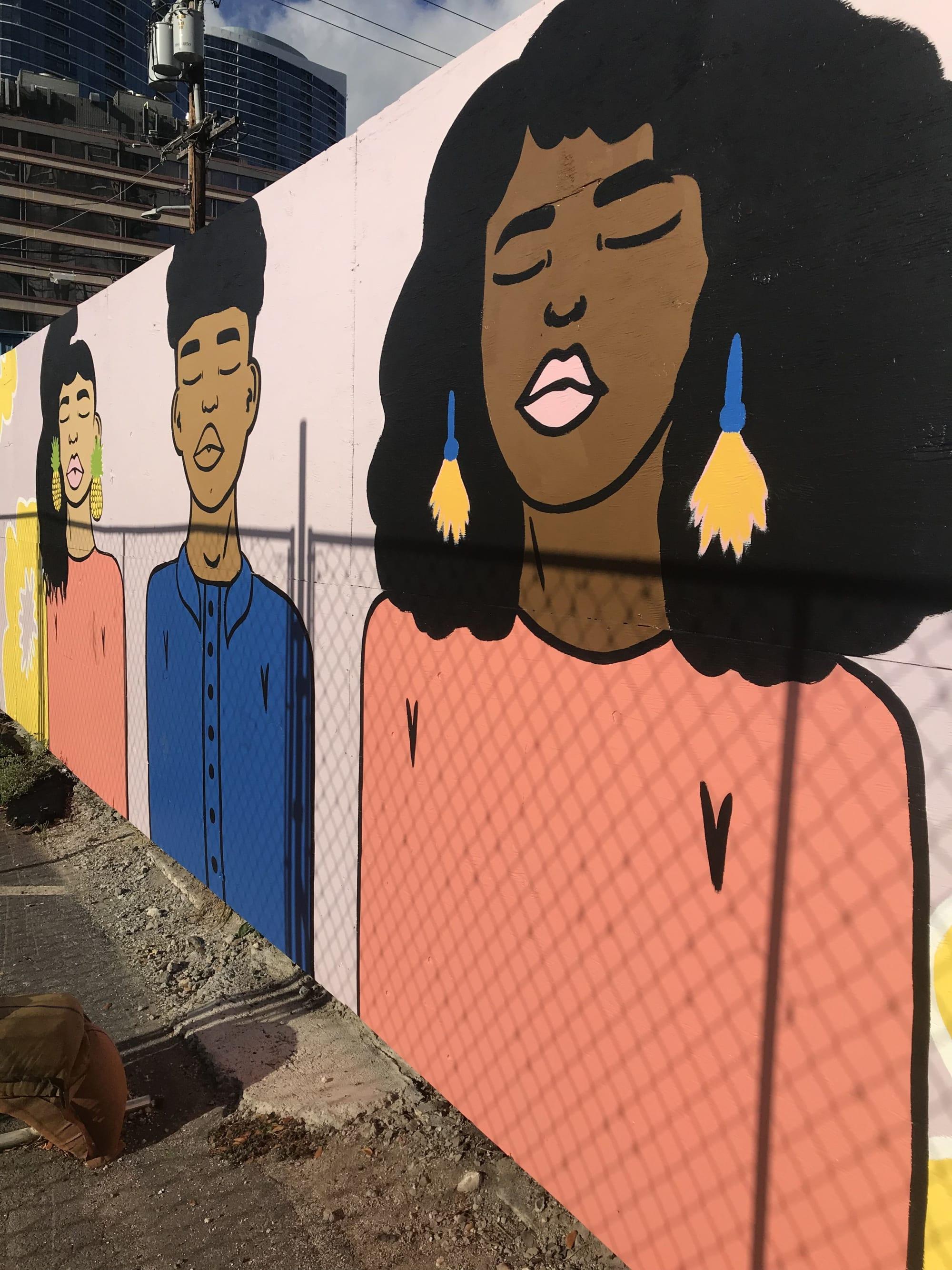 Girl with tassel earrings mural