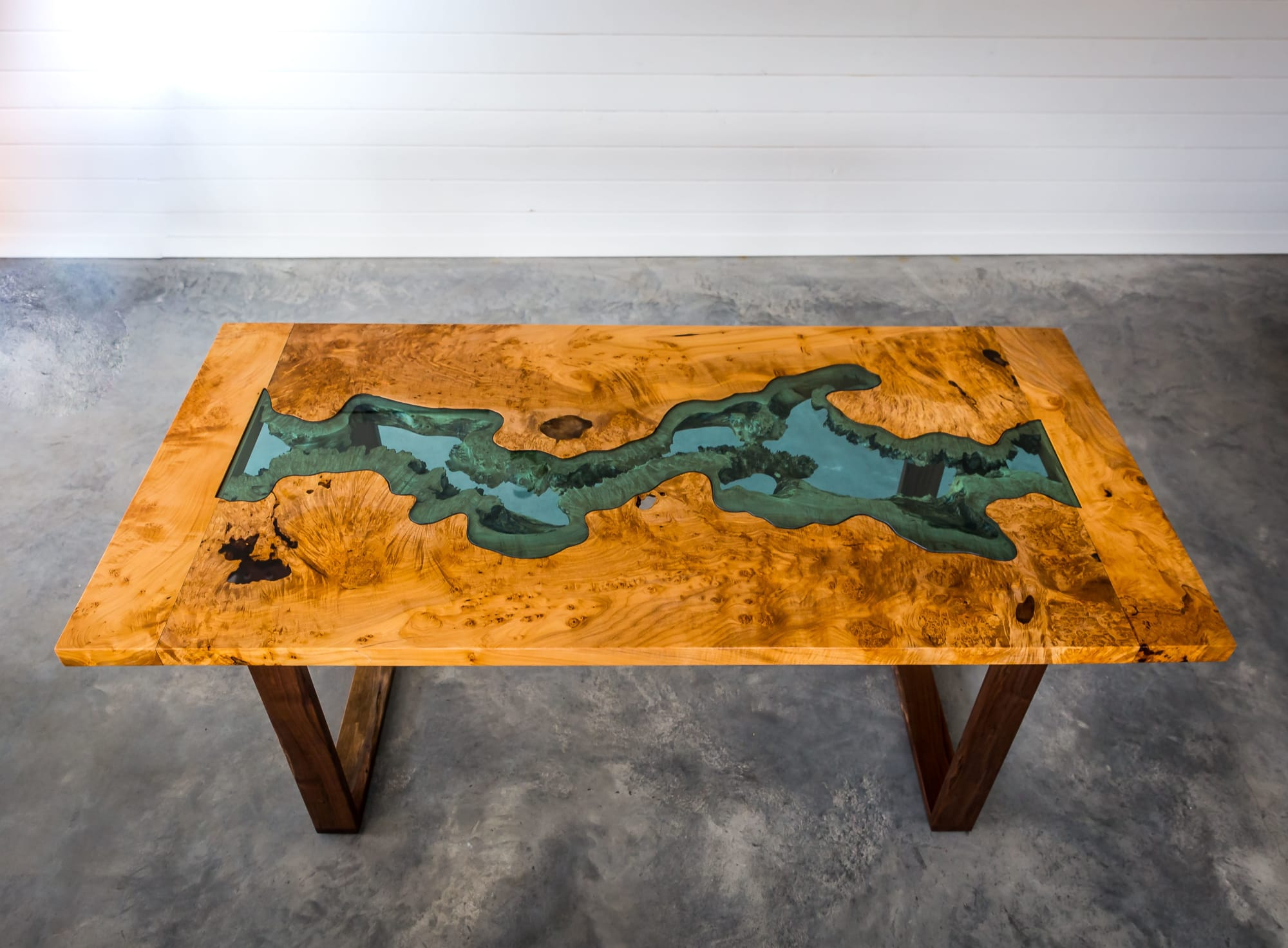 Natural wood enclosed river table