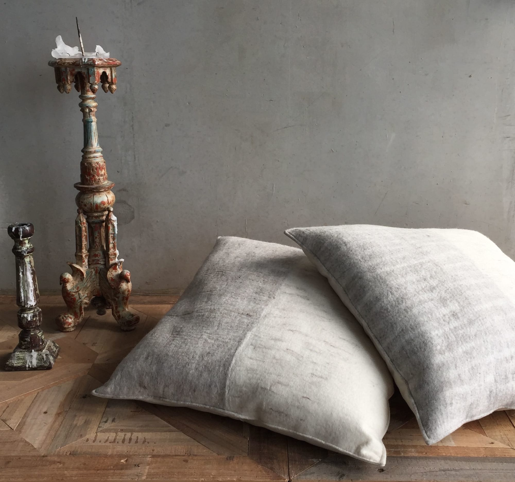Grey and white square floor cushions