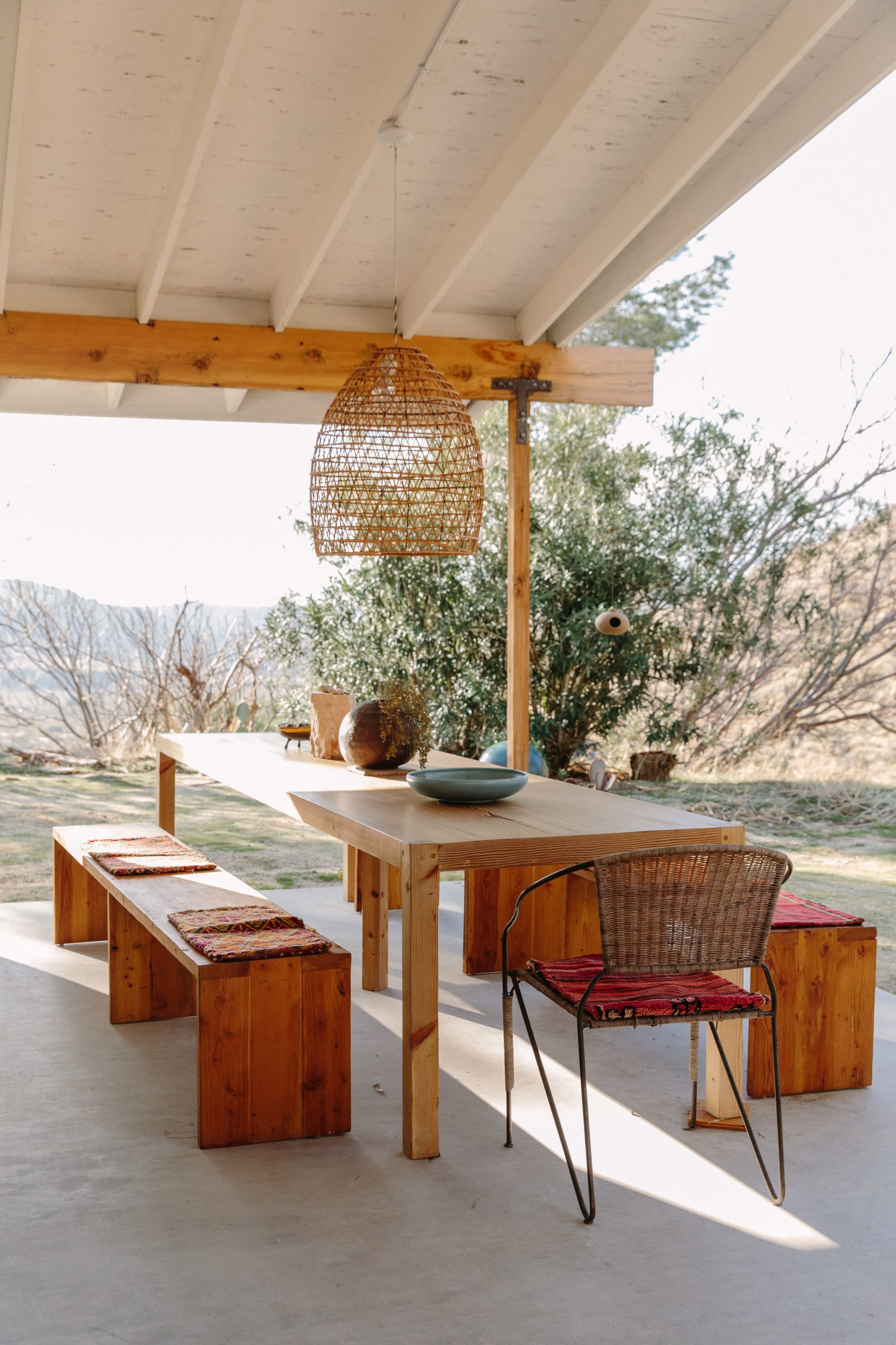 Outdoor wooden dining table and benches